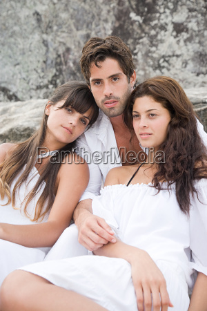 young man and two young women