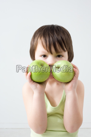 boy with two apples