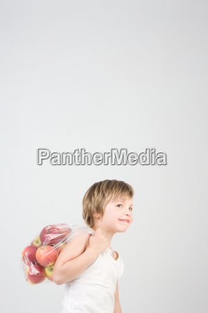 boy with bag of apples