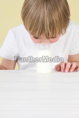 boy smelling yoghurt