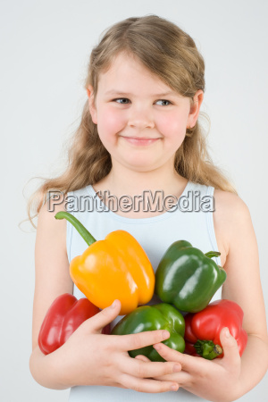 girl holding peppers