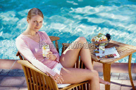 woman relaxing by pool