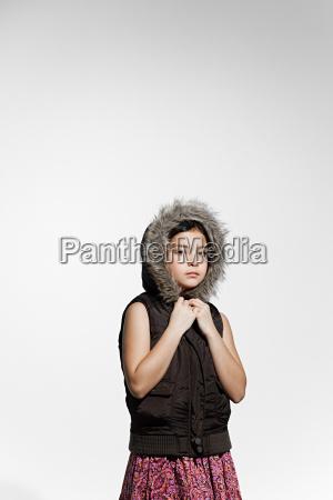 girl wearing fur hood