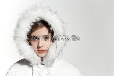 girl wearing a white coat with