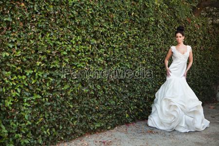 young woman wearing wedding dress standing