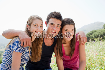 three young friends looking at camera
