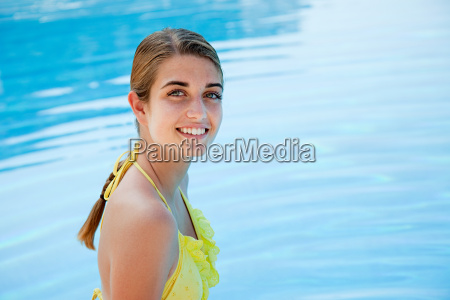 young woman in yellow bikini by