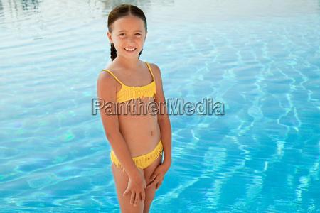 girl in yellow bikini by swimming