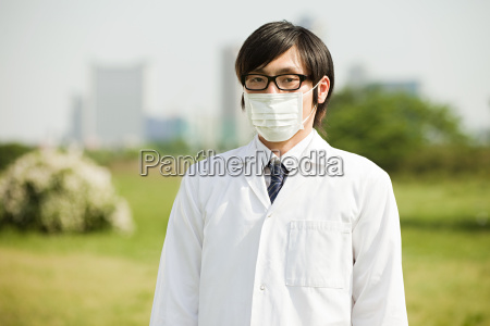 portrait of young man wearing pollution