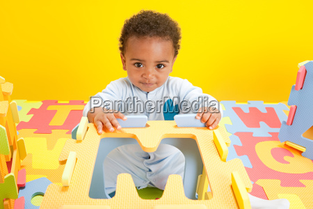 baby boy playing with toy alphabet