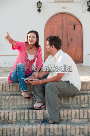 young couple sitting on steps