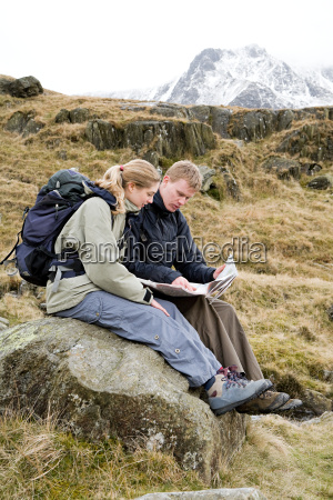 a couple looking at a map