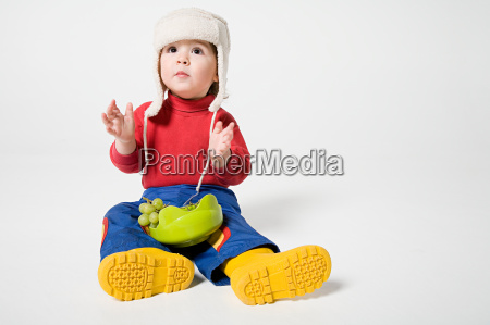 a boy holding a bowl of
