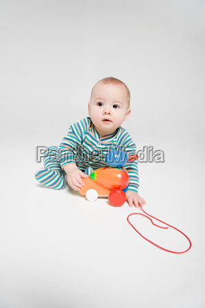 a baby boy playing with a