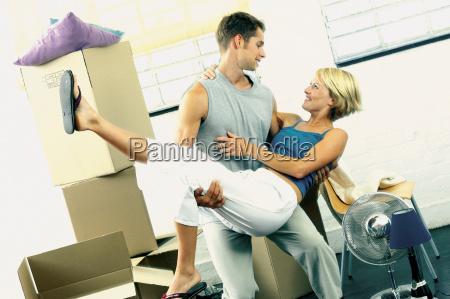 man carrying woman playfully