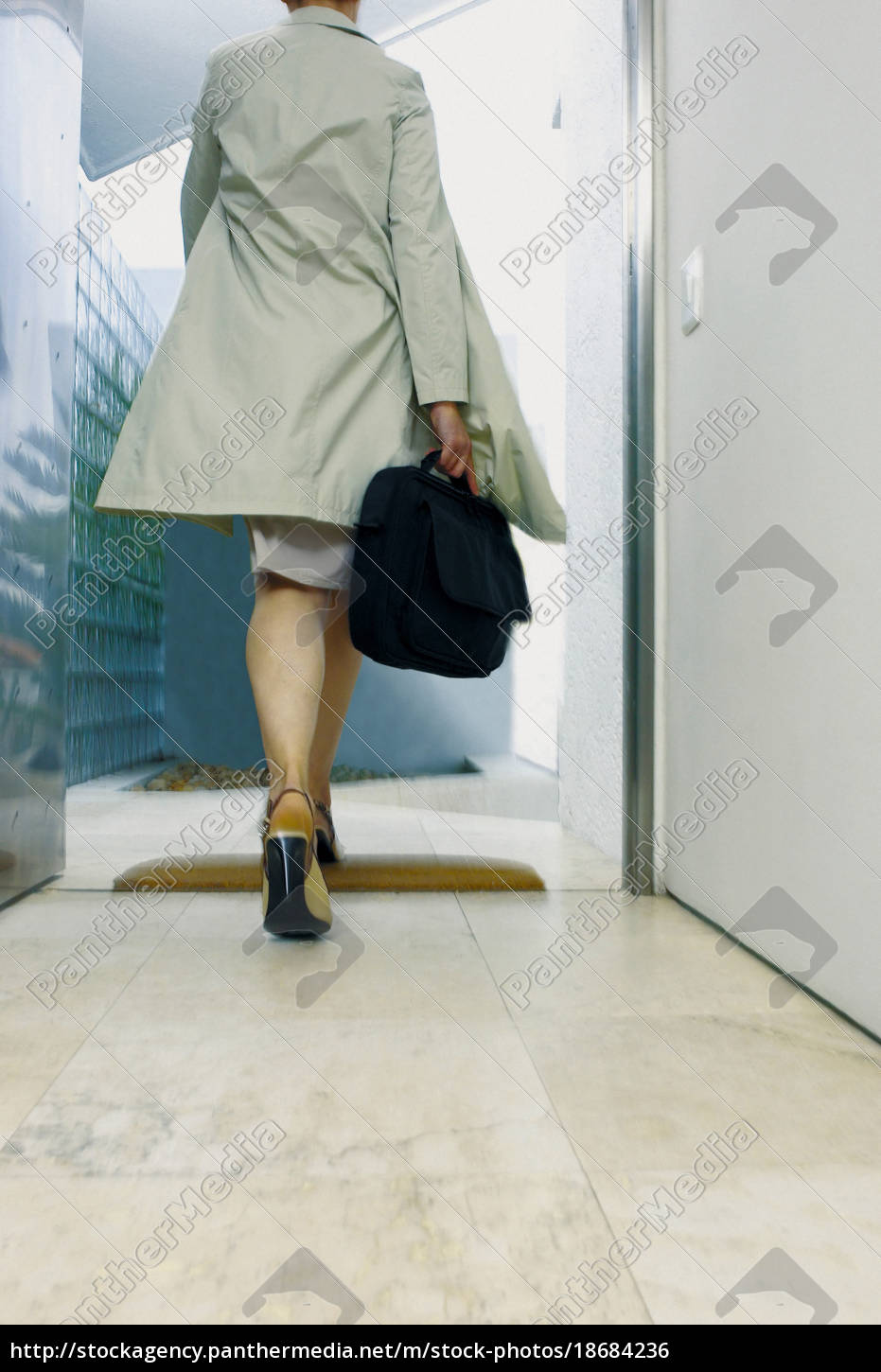 businesswoman, leaving, the, office - 18684236