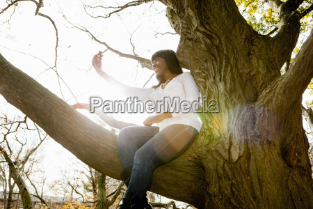 young woman taking self portrait whilst