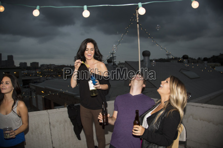 young adult friends blowing bubbles at