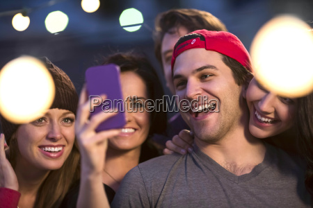 young adult friends taking selfie at