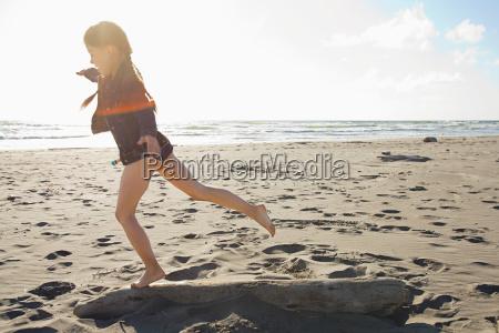 girl running along beach