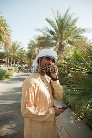 middle eastern man listening to music