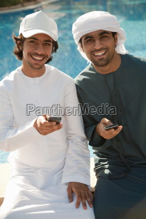 two middle eastern men with mobile
