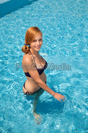 young, woman, in, swimming, pool, , high - 18693784