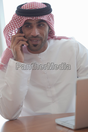 middle eastern businessman with cellphone and