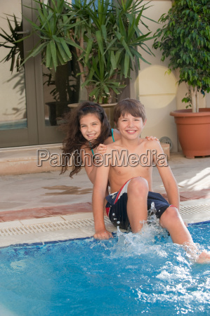 brother and sister at the pool