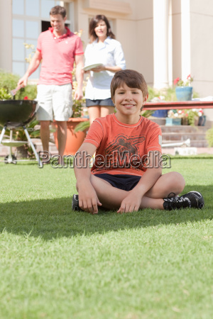 young boy in the garden with