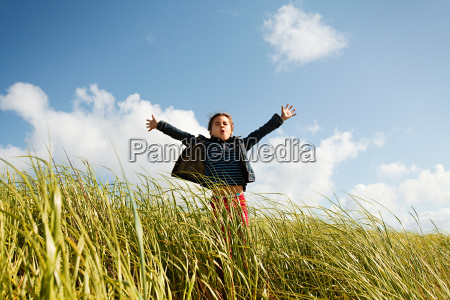 girl holding arms out in long