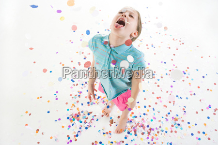a girl playing in confetti