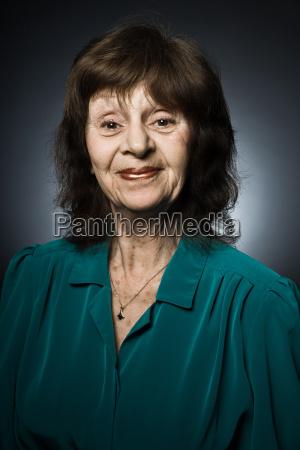 stuido portrait of cheerful senior woman