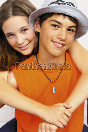 teenage boy and girl embracing