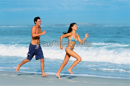 woman and man jogging on the