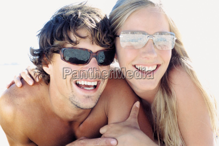 romantic man and woman on beach