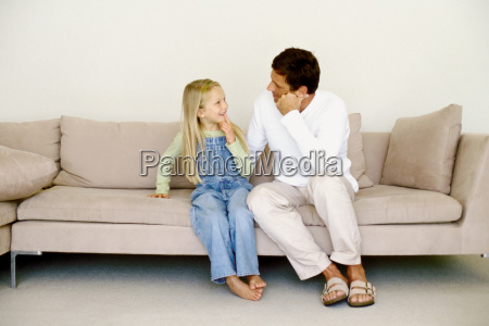 father and daughter on sofa