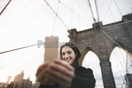 young woman taking selfie on brooklyn