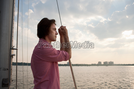 mid adult man on board yacht