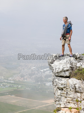 man standing on a rock