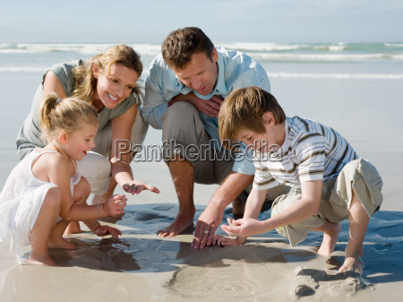 family looking in sand