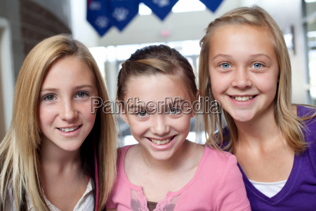 close up portrait of three teen