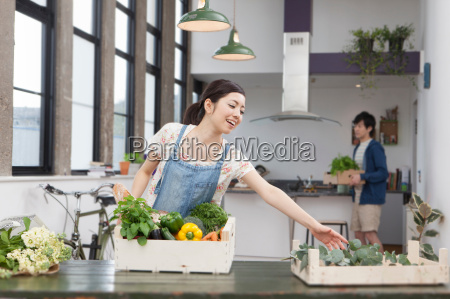 young couple in kitchen preparing fresh