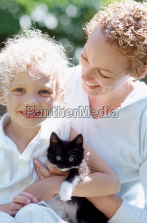 mother and daughter with cat