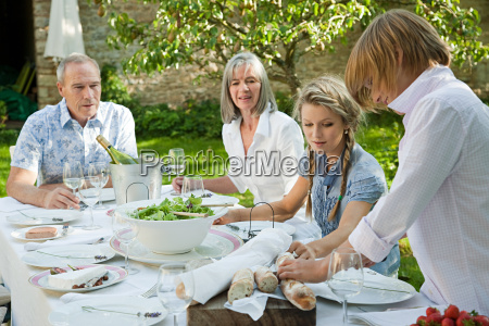family eating lunch outdoors