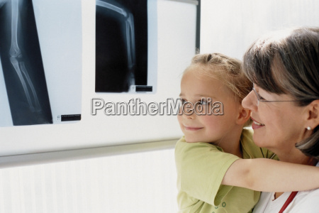 girl and doctor examining x ray
