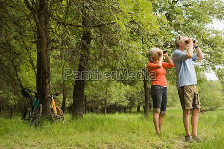 mature couple with binoculars