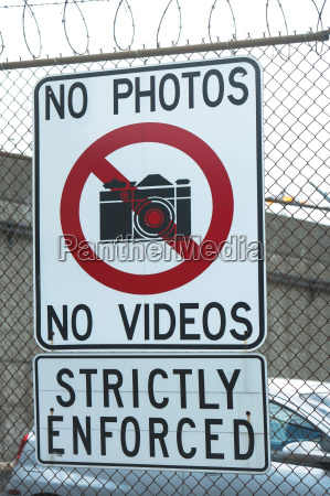 no photography sign on wire fence