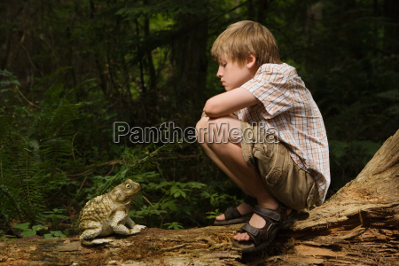 boy looking at toad