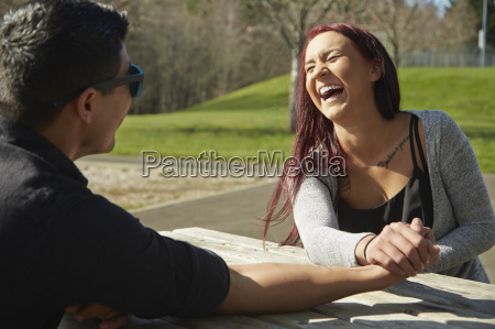 young couple holding hands and laughing